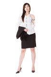 Confident business executive woman. Of Asian standing and holding her coat, full length portrait isolated on white background Royalty Free Stock Photo