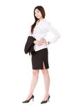 Confident business executive woman. Of Asian standing and holding her coat, full length portrait isolated on white background Stock Photos