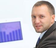 Confident business man. Closeup portrait of confident business man using laptop while looking at you Stock Images