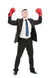 Confident business man acting like a champion Royalty Free Stock Photography