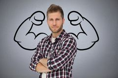 Confident business man  against grey background with drawing of  flexing muscles Royalty Free Stock Image