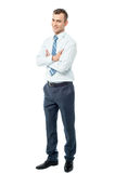 Confident business man with arms crossed. Handsome businessman standing with arms crossed Royalty Free Stock Photos