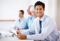 Confident business man attending a meeting Stock Image