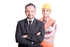 Confident business man and construction worker Stock Image