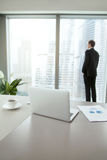 Confident business man contemplating in his office Royalty Free Stock Image