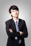 Confident business man cross his arms Stock Image