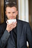 Confident Business Man Drinking Coffee Stock Photo