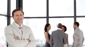 Confident business man in font of business team royalty free stock images