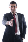 Confident business man giving you a hand shake Stock Photos