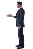 Confident business man giving you a hand shake Stock Images