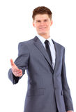 Business man giving you a hand shake. Confident business man giving you a hand shake on white background Stock Image