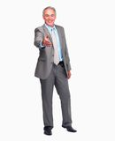 Confident business man with his hand stretc Stock Images