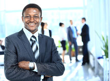 Confident business man with his team Royalty Free Stock Photo