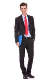Confident business man holding a clipboard Royalty Free Stock Photos