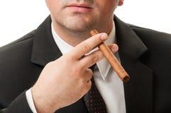 Confident business man holding a cuban cigar Stock Photo