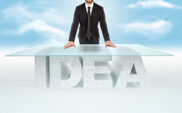 Confident business man leaning on empty glass table with a base made of concrete IDEA against the sky background. Bussines concept Royalty Free Stock Photos