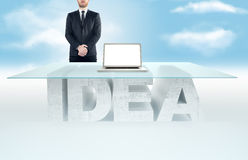 Confident business man leaning on empty glass table with a base made of concrete IDEA table against the sky background. Business c. Empty glass table with a base stock photos