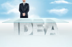 Confident business man leaning on empty glass table with a base made of concrete IDEA table against the sky background. Business c. Empty glass table with a base royalty free stock photo