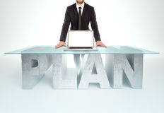 Confident business man leaning on PLAN table. Bussines concept Royalty Free Stock Image