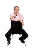 Confident business man sitting on a chair Royalty Free Stock Images