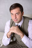 Confident business man sitting portrait - stock photo Royalty Free Stock Images