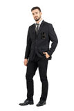 Confident business man in suit with sunglasses in pocket looking at camera Royalty Free Stock Images