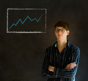 Confident business man or teacher with arms crossed against a bla Royalty Free Stock Photos