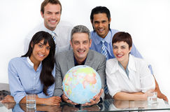 Confident business partners holding a globe Royalty Free Stock Photo