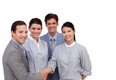 Confident business partners shaking hands Stock Photos