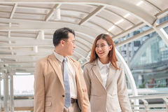Confident business partners walking down in office building and Royalty Free Stock Photos