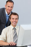 Confident business partners working at a computer Stock Photography