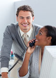 Confident business partners working at a computer Stock Image