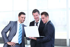Confident business partners working in office and talking Royalty Free Stock Photo