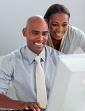 Confident business partners working together Stock Photo