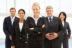 Confident business people. Standing outside office smiling Stock Photo