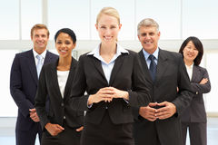 Confident business people. Smiling at camera Royalty Free Stock Photos