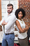 Confident business people with arms crossed in office Royalty Free Stock Photos