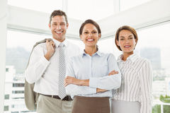 Confident business people with arms crossed in office Royalty Free Stock Photography