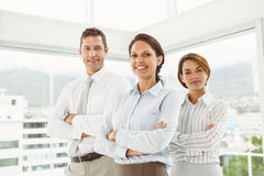 Confident business people with arms crossed in office Stock Photos