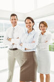 Confident business people with arms crossed in office Stock Image