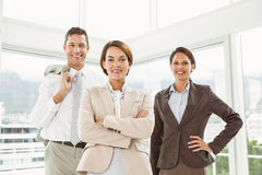 Confident business people with arms crossed in office Stock Photo