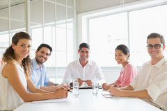Confident business people at conference table Stock Image