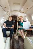 Confident Business People In Corporate Jet Stock Photos