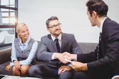 Confident business people handshaking royalty free stock photos