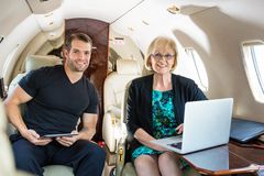 Confident Business People On Private Jet Royalty Free Stock Photography