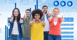 Confident business people showing thumbs up sign against graphs Royalty Free Stock Photo