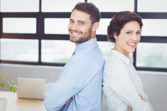 Confident business people standing back to back Stock Photo