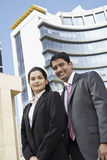 Confident Business People Standing In Front Of Building Stock Photo