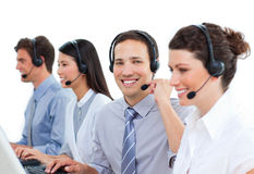 Confident business people talking on headset Stock Photography