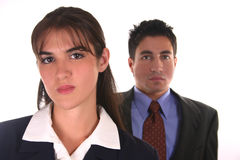 Confident business team. Woman in front and man behind Royalty Free Stock Photo